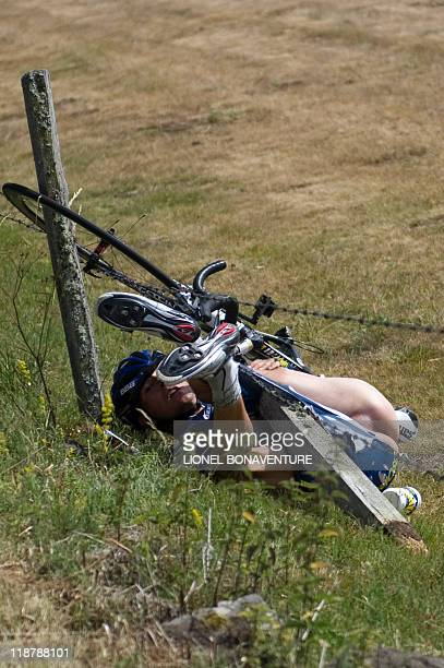 One of the breakaway men Netherland's Johnny Hoogerland is stuck in a barbedwire fence after he crashed at the side of the road during the 208 km and...