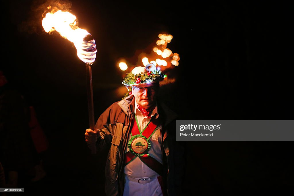 One of The Chanctonbury Ring Morris Men takes part in the Apple Howling ceremony at Old Mill Farm on January 3, 2015 in Bolney, England. In this ancient ritual villagers surround the oldest and largest tree in the orchard, evil spirits are driven out and good spirits are encouraged to produce a bountiful apple crop for the following year's cider drink.