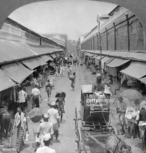 One of the chief native market streets, Rangoon, Burma, 1908. Stereoscopic card. Detail.