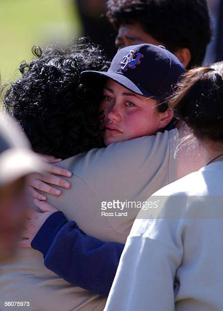 One of the children sheds tears of joy when reunited with family members after spending the morning at Auckland central Police station following the...