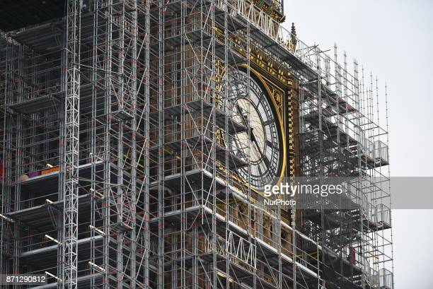 One of the clocks of the Elizabeth Tower commonly known as Big Ben is seen through the scaffolding that entirely cover it London on November 7 2017