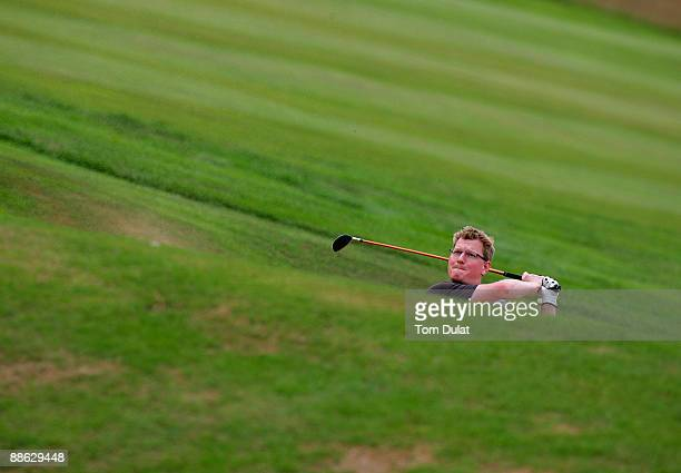 One of the competitors plays oout of the bunker on 17th fairway during the Virgin Atlantic PGA National ProAm Championship Regional Qualifier at The...