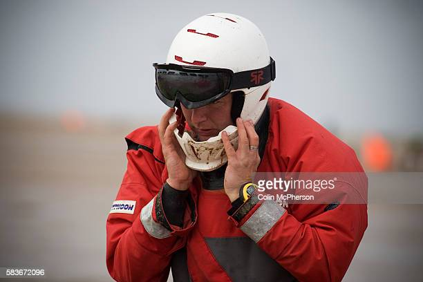 One of the competitors putting on his crash helmet before one of the races at the European Kite Buggy Championships at Hoylake Wirral north west...