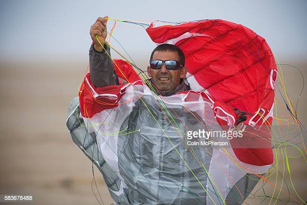 One of the competitors untangling a kite before one of the races at the European Kite Buggy Championships at Hoylake Wirral north west England Around...