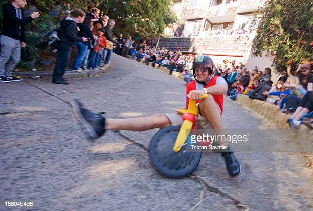 """One of the contestants at the """"Bring Your Own Big Wheel"""" race. BYOBW is a free and unauthorized event. People race with Big Wheel toy tricycles and..."""