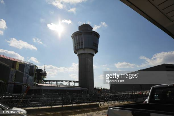 One of the control towers stands at LaGuardia Airport after the Federal Aviation Administration announced it is delaying flights into multiple...