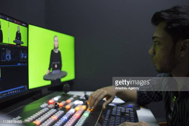 One of the crew and a Rohingya refugee Anis Islam controls the video mixer console during the recording session at Rohingya Vision TV studio in Kuala...