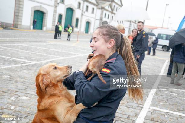 """One of the crewmembers of the frigate """"Mendez Nuñez"""" with her dogs after more than seven months of circumnavigation on November 28 2019 in La Coruña..."""