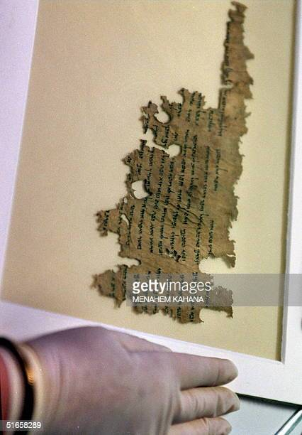 One of the Dead Sea scrolls of the prophet Ezekiel which were dIscovered fifty years ago is displayed 20 July at the Rockefeller Museum in Jerusalem...