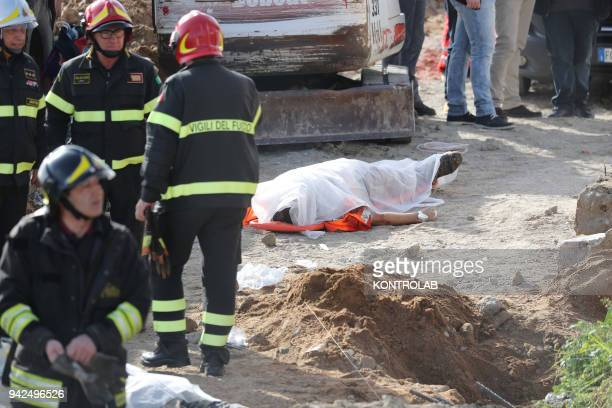 One of the dead workers to the site of the accident at work in Crotone Calabria southern Italy where two workers died and one third is seriously...