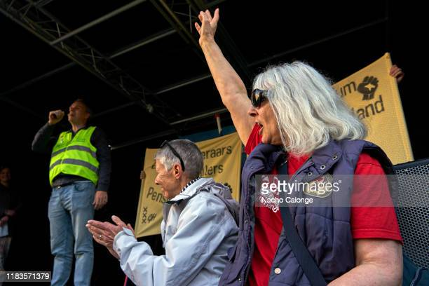 One of the demonstrators encourages one of the speakers during the demonstration for the basic income on October 26 2019 in Amsterdam Netherlands The...