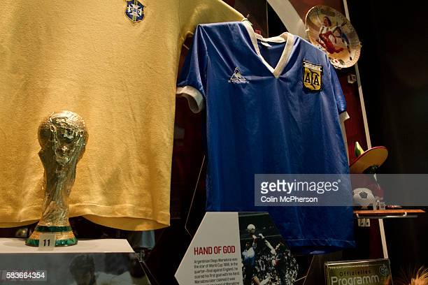 One of the displays featuring Maradona's 'Hand of God' shirt at the newly0opened National Football Museum in Manchester The new museum based in the...