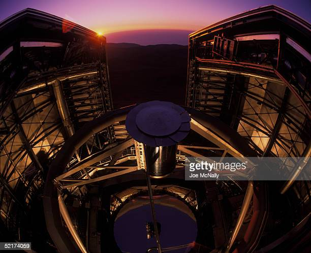 One of the domes of the Very Large Telescope opens to the setting sun 1999 in northern Chile The Very Large Telescope consists of four squaredoff...