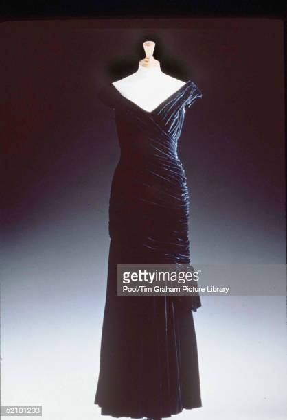 One Of The Dresses In Christie's Diana Dresses Auction On Prior Display In London. An Ink Vlue Velvet Dress By Victor Edelstein Worn At The White...