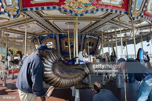 One of the eagles is installed onto the carousel Workers from left to right are Keyo Garris Brendon Ford and Derek Schrag National Harbor is adding a...