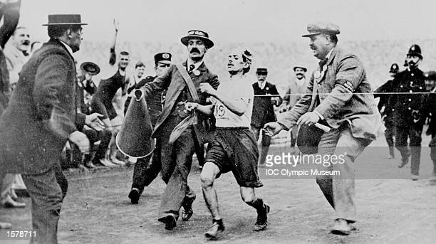 One of the earliest Olympic dramas captured on photo was the marathon runner Dorando Pietri of Italy here reaching the tape in the race at the London...