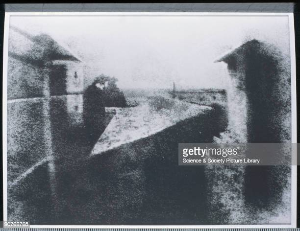 One of the earliest surviving camera photographs by Joseph Nicephore Niepce 'The surface irregularities of the original plate have been emphasised by...