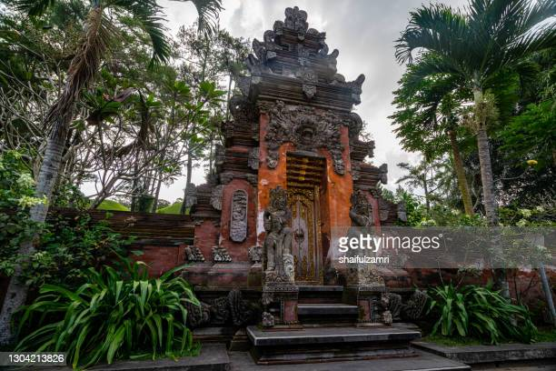 one  of the entrance to small  temple in district ubud, bali, indonesia. - shaifulzamri stock pictures, royalty-free photos & images