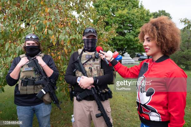 One of the event's conservative speakers interviews militia members before the march begins. September 12, 2020. A group of around 200 Trump...