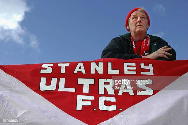 One of the famous Accrington Stanley fans the 'Stanley Ultras' watches the action during the Nationwide Conference match between Accrington Stanley...