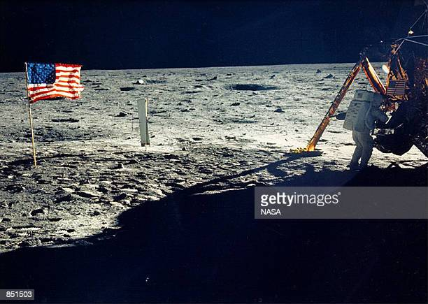 One of the few photographs of Neil Armstrong on the moon shows him working on his space craft on the lunar surface The 30th anniversary of the Apollo...