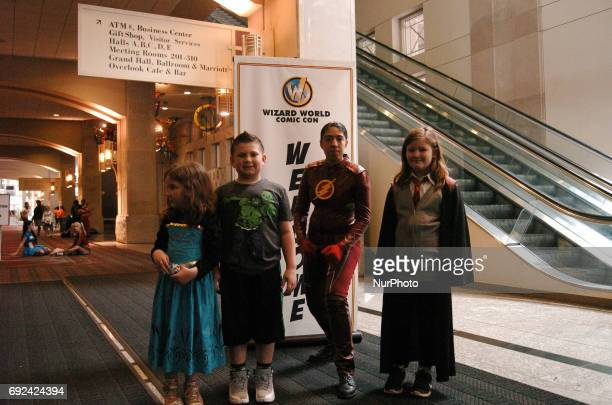 One of the few Wizards at Wizard World Philadelphia this year poses with her family on the last day of the comic con in Philadelphia PA on June 4 2017