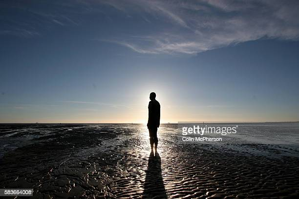 One of the figures inAnthony Gormley's installation on Crosby beach near Liverpool on Merseyside entitled Another Place which consists of 100 sixfoot...