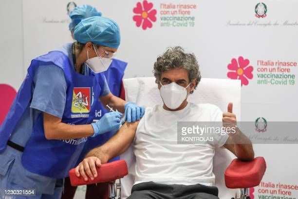 One of the first doses of the Pfizer-Biontech vaccine against Covid-19, during the v-day in Sicily, is administered to a chosen person with an...