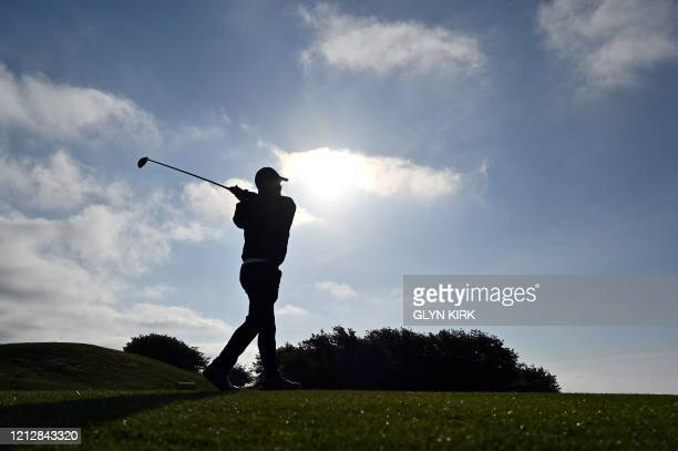 one of the first members on the course David Scales tees off from the 3rd Tee at The Dyke Golf Club on the south coast of England on May 13 as the...