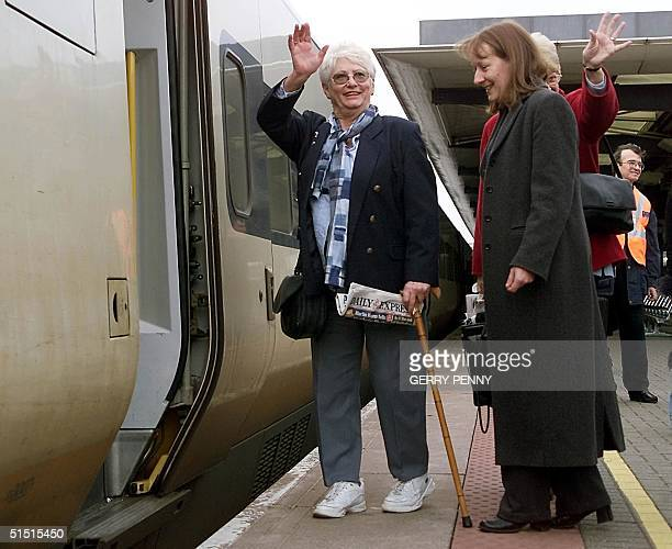 One of the first of nine National Health Service patients boards the EuroStar train at Ashford International Station Kent 18 January 2002 enroute to...