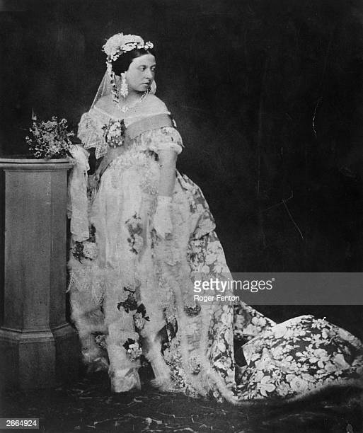 One of the first photographs for which Queen Victoria ever posed Her ornate gown is embroidered with flowers and edged with lace