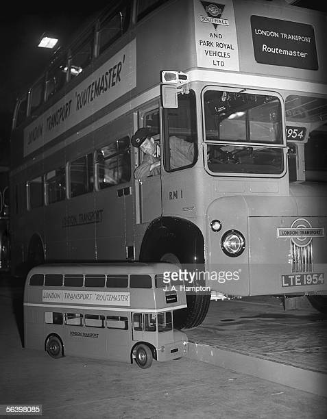 One of the first two Routemaster buses ever built on display with a scale model at the Commercial Motor Show at Earl's Court London 23rd September...
