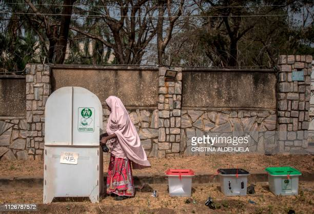 TOPSHOT One of the first voters casts their ballots at Unguwar Sarki polling station in Kaduna on February 23 as Nigeria votes to elect its new...