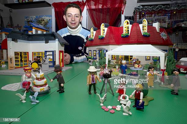 One of the founder of French society 'Klikobil' Olivier Boulanger poses in his shop on December 14 2011 in DremilLafage near Toulouse Klikobil...