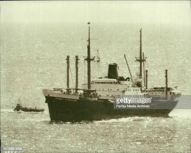 One of the four ships which suppose to have time bomb aboard Straat Singapore entering Sydney Harbour at 11am this morning accompanied by launch with...