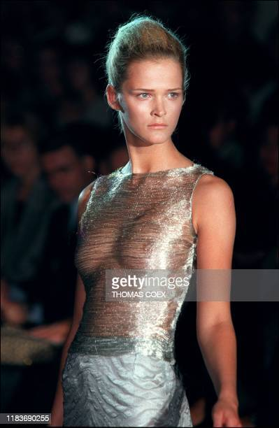 One of the futuristic models from the Versace 1998/99 Fall/Winter high fashion collection shown in Paris 18 July was this shiny sheer top in silvery...