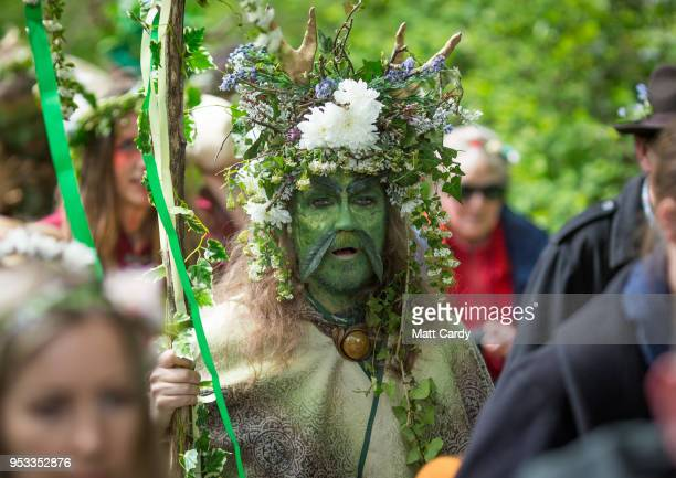 One of the Greenmen of Glastonbury is pictured as he walks with this year's Maypole through the centre of Glastonbury to a ceremony at Bushy Combe...