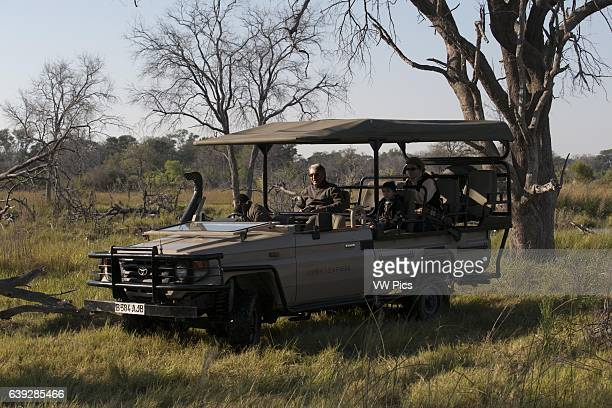 One of the guides in the 4x4 where safaris are conducted in the Okavango Delta camp near Khwai River Lodge by Orient Express in Botswana within the...