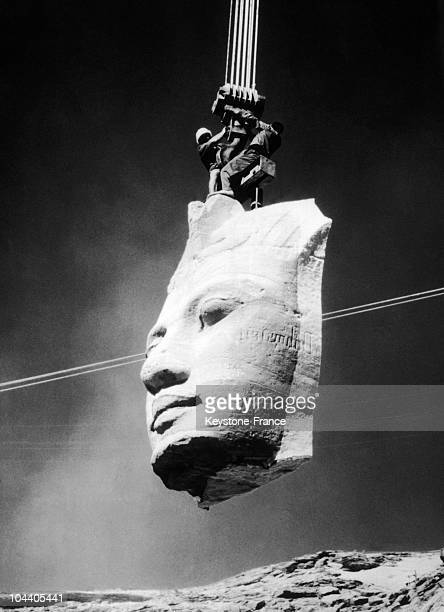 One of the heads of the Pharaoh RAMSES II which was on the facade of the great temple of Abu Simbel in Nubia Egypt being carried by cranes to the...
