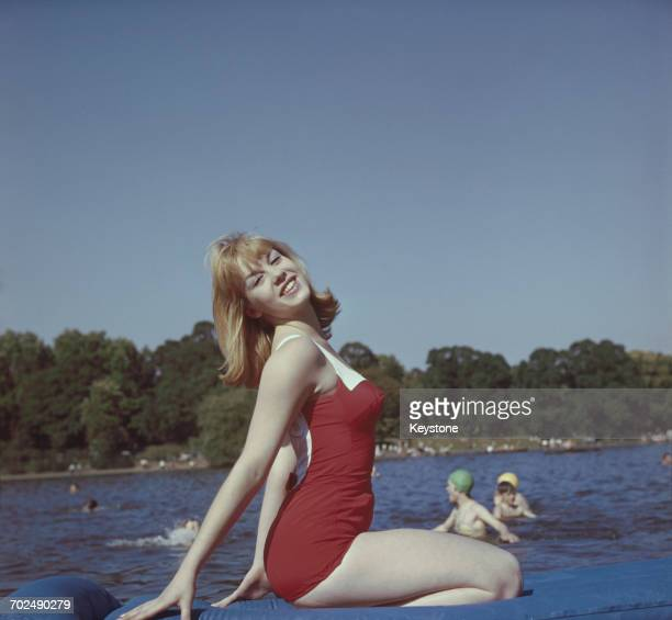 One of the identical twin actresses Susan and Jennifer Baker swimming in a London park in 1962