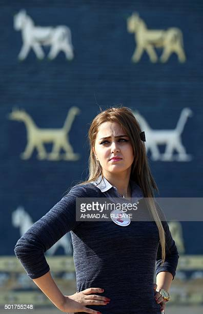 One of the Iraqi candidates for Miss Iraq beauty contest poses in front of the Ishtar Gate at the ancient archaeological site of Babylon south of the...