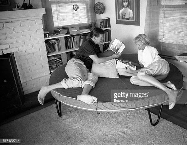 One of the items which they received in trade for paintings this circular couch used as a bed at night makes a comfortable place to relax for Walter...