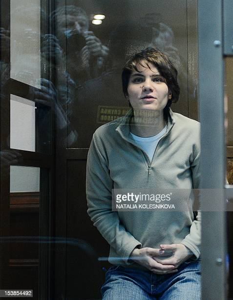 One of the jailed members of the allgirl punk band Pussy Riot Yekaterina Samutsevich sits in a glasswalled cage in a court in Moscow on October 10...