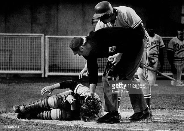 MAY 13 1975 MAY 14 1975 One of the Joys of Being A Catcher Denver Bears catcher Jeff Sovern writhes on the ground after being hit by a foul tip in...