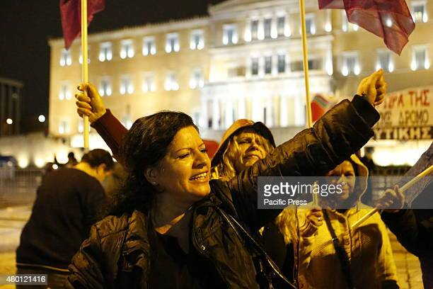 One of the laid-off government cleaners shouts slogans towards the Greek Parliament. Greek protesters from SYRIZA , the main opposition party in the...