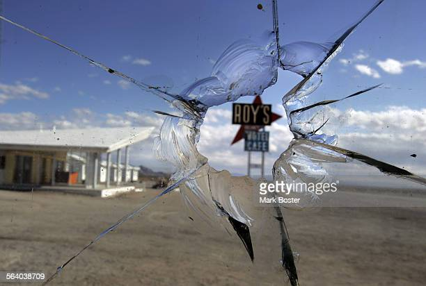 –One of the landmarks of Amboy Roy's Motel Cafe is framed by a bullet hole in the window of the shuttered gas station Located in the desert off Hwy...