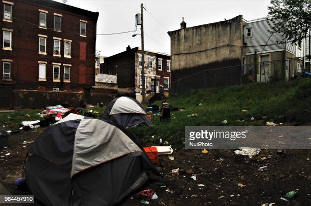 One of the last people to wake up prepares for the long day ahead on a trashstrewn grassy hill at lacking the basic right to privacy homeless folks...