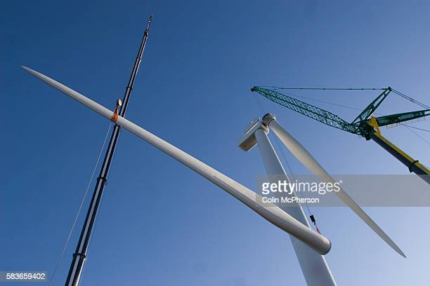 One of the last remaining 11ton blades on a 25 megawatt wind turbine at Alexandra Dock in Liverpool is lifted into place by cranes The monthlong...
