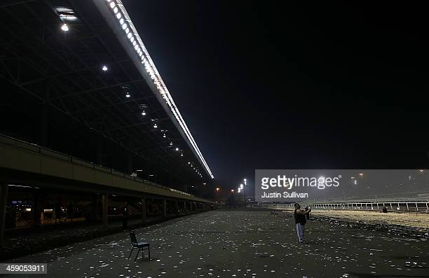 One of the last remaining race fans stops to take picture of the track after the final race at Betfair Hollywood Park on December 22 2013 in...