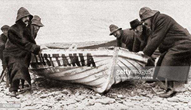 One of the lifeboats from the RMS Lusitania sunk by a German Uboat in 1915 is hauled onto the beach on the coast of Ireland From The Pageant of the...